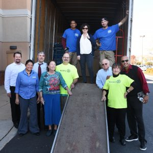 group at moving truck ramp