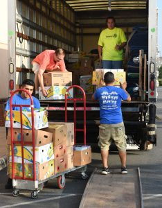 2 movers loading with rotarians