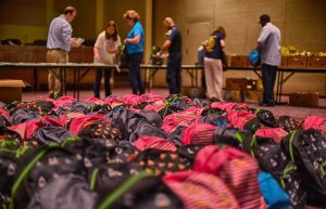 backpacks being filled